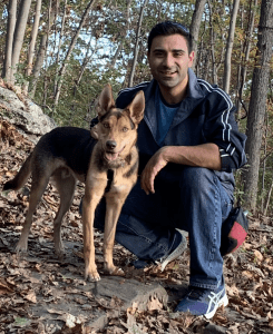Anthony and his puppy Journey hiking in the woods